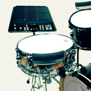 Drumming with backing tracks and sample pads
